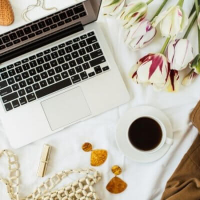 laptop flatlay - tulips, coffee, accessories, shoes - Best Books for Bloggers