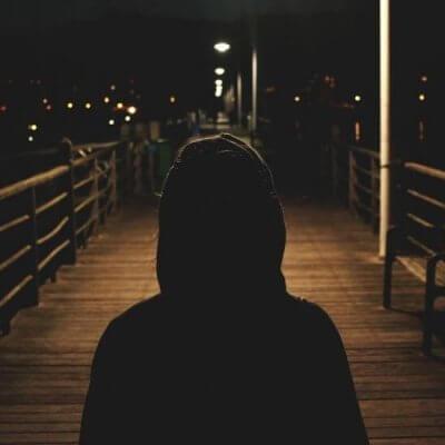 Man standing on dock at night