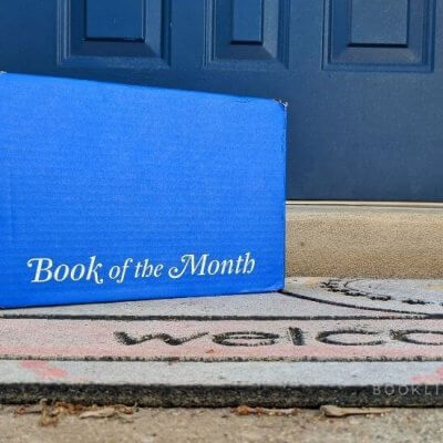 Book of the Month blue box, welcome mat, front door