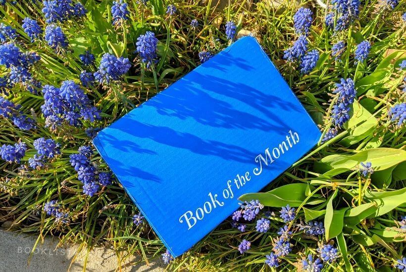 Book of the Month May 2021 Selections - blue box in purple flowers