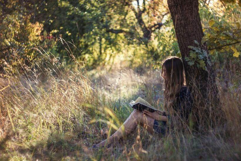 woamn reading in the woods