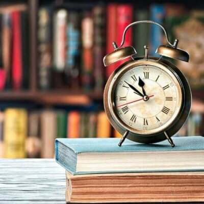 clock on two books in library
