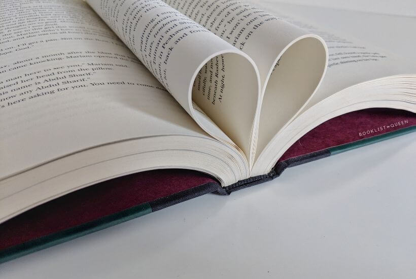 open book with pages forming a heart