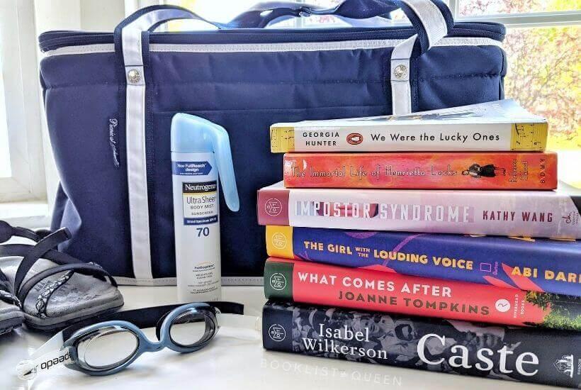 navy cooler, sunblock, summer reading book stack, googles, sandals
