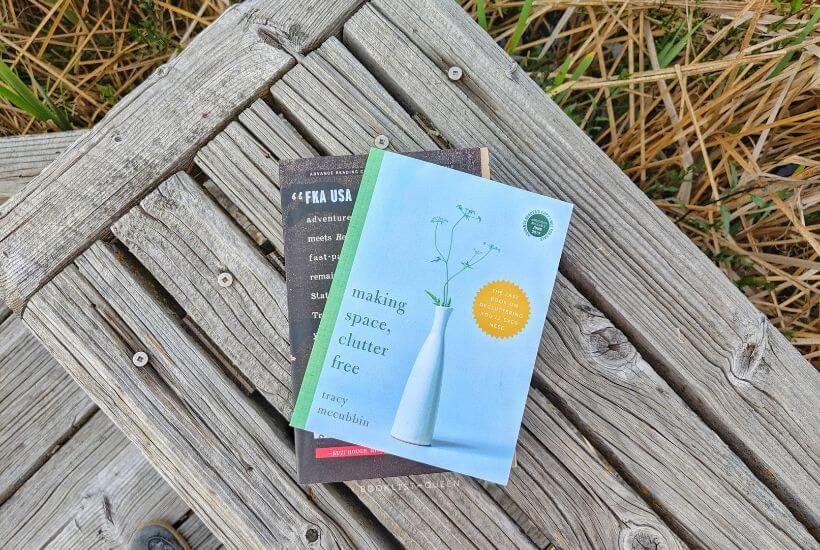 two books on a wooden bench