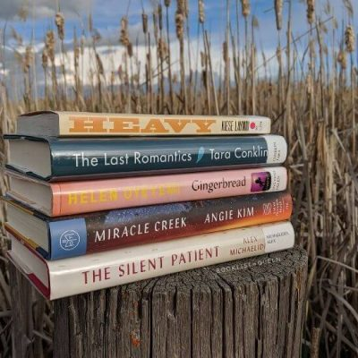 book stack in front of cattails