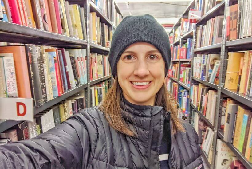 Rachael in front of bookshelves at The Strand