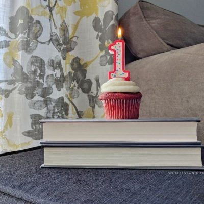 Cupcake, number one candle, bookstack