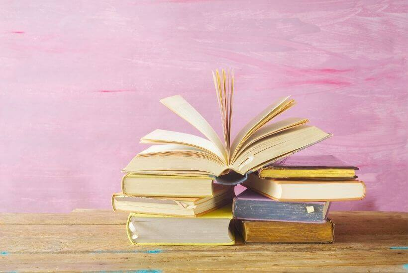 book stack against pink background