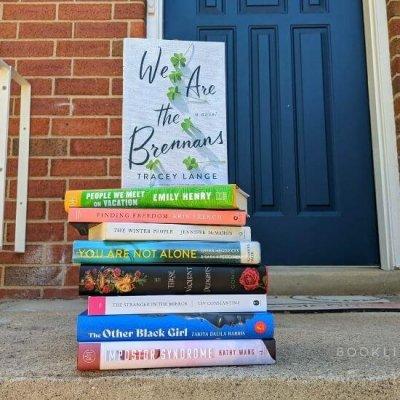 book stack by Rachael's front door
