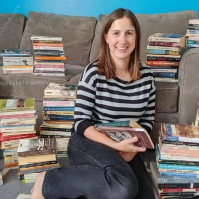 Rachael surrounded by piles of books