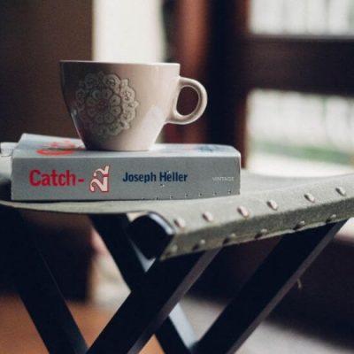 Catch 22 and coffee mug