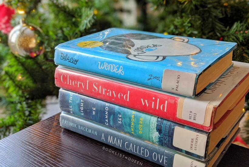 book stack in front of Christmas tree