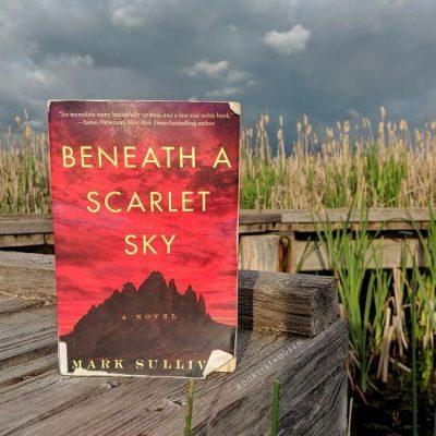 Beneath a Scarlet Sky on boardwalk